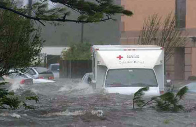 A Red Cross disaster relief truck is caught in the flood