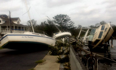 Boats pushed ashore by Hurricane Katrina