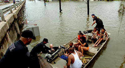 New Orleans Police officers assist Hurricane Katrina survivors