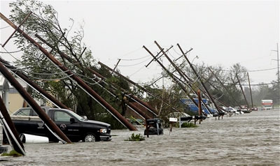 Powerline poles nearly pushed to the ground by Hurricane Katrina