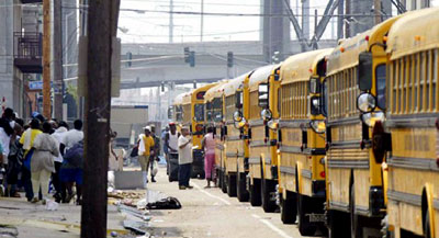 A line of school buses prepare to evacuate Hurricane Katrina survivors